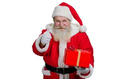Portrait of Santa Claus with red gift box. Royalty Free Stock Images