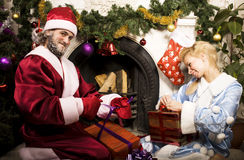 Portrait of Santa Claus with Snow Maiden at Cristmas tree Stock Photo