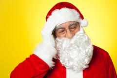 Portrait of Santa Claus suffering from headache Stock Photo