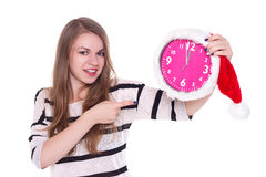 Portrait of santa girl with clock. white background Royalty Free Stock Photo