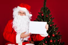 Portrait of a santa holding blank placard Stock Image