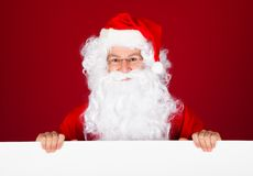 Portrait of a santa holding blank placard Royalty Free Stock Image