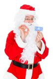 Portrait of santa holding credit card Stock Images