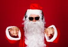 Portrait of a santa listening music Royalty Free Stock Photo