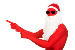 Portrait of santa man in latex clothing pointing Royalty Free Stock Photos