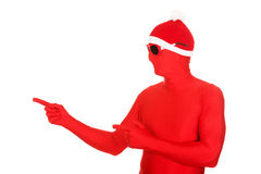 Portrait of santa man in latex clothing pointing Stock Photo