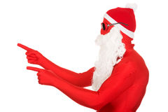 Portrait of santa man in latex clothing pointing Stock Photography