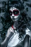 Portrait of santa muerte girl prepaired for Halloween Stock Images