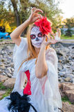 Portrait of Santa Muerte. Portrait of a young girl in the image of the Mexican Santa Muerte Stock Photography