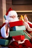 Portrait of Santa with pile of Christmas presents Stock Photos