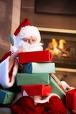 Portrait of Santa with pile of Christmas presents Royalty Free Stock Photo