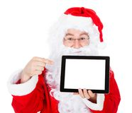 Portrait of santa pointing at digital tablet Royalty Free Stock Image