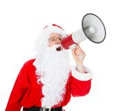 Portrait of santa shouting in megaphone. Over white background Stock Photography