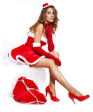 Portrait of a santa woman with a christmas gift Royalty Free Stock Image