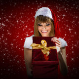 Portrait of a santa woman with a christmas gift Stock Photos