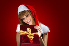 Portrait of a santa woman with a christmas gift Royalty Free Stock Photography