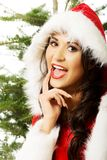 Portrait of santa woman with christmas tree Royalty Free Stock Image