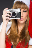 Portrait of a santa woman with a old camera Stock Photo