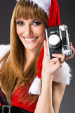 Portrait of a santa woman with a old camera Royalty Free Stock Images