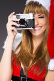 Portrait of a santa woman with a old camera Stock Images