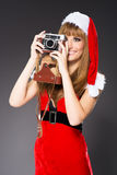 Portrait of a santa woman with a old camera Stock Photography