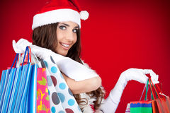 Portrait of a  santa woman with shopping bags Stock Photography