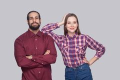 Portrait of satisfied bearded man and woman in casual style stan royalty free stock images