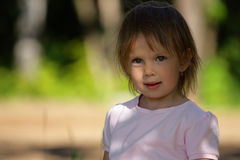 Portrait of satisfied beauty girl. Portrait of satisfied little beauty girl smile a little. Outdoor, at careless background royalty free stock photos