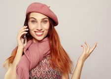 Lifestyle and people concept: Portrait of a satisfied casual girl holding mobile phone and showing ok gesture royalty free stock photo
