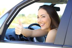 Satisfied driver with thumbs up in a car Stock Images