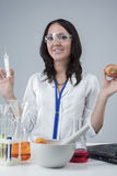 Portrait of Satisfied Female Laboratory Staff with Syringe and Apple Test Sample. Royalty Free Stock Photo