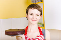 Woman cooking easter chocolate cake at home Stock Image