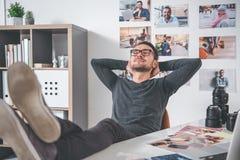 Joyful male resting at work royalty free stock image