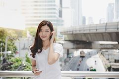 Portrait satisfy beautiful customer woman. Charming beautiful woman is chatting or talking to someone by using smart phone and ha royalty free stock image