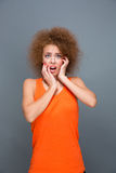 Portrait of scared curly girl Royalty Free Stock Photography