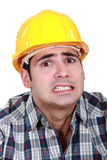 Portrait of scared laborer Stock Photo
