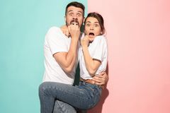 Portrait of the scared man and woman on pink and blue Stock Photography