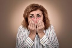 Portrait of scared middle-aged woman royalty free stock photography