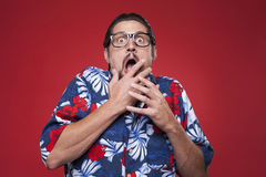 Portrait of a scared young man against red background Royalty Free Stock Photography