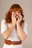 Portrait scaring woman. Portrait red haired scaring woman Stock Image