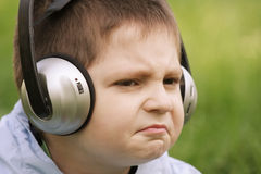 Portrait of sceptic boy in headphones Stock Images