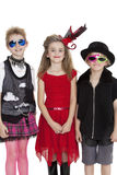Portrait of school children wearing fancy dress outfits over white background Royalty Free Stock Photography