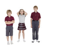 Portrait of school friends standing together over white background Royalty Free Stock Photo