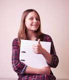 Portrait of a school girl with folder Stock Images