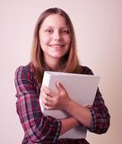 Portrait of a school girl with folder Stock Photography
