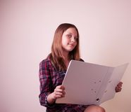 Portrait of a school girl with folder royalty free stock photo