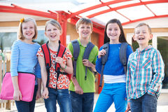 Portrait Of School Pupils Outside Classroom Carrying Bags Royalty Free Stock Photo