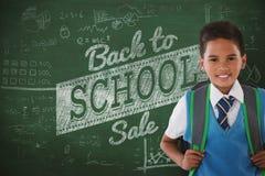 Composite image of portrait of schoolboy carrying schoolbag against white background. Portrait of schoolboy carrying schoolbag against white background against Stock Photo