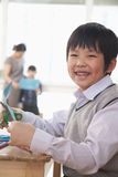 Portrait of Schoolboy doing arts and crafts, Beijing Stock Photography