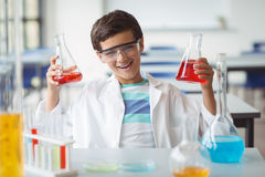 Portrait of schoolboy doing a chemical experiment in laboratory. At school Royalty Free Stock Image